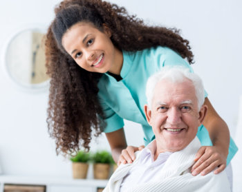 caregiver assisting her elderly patient for meal
