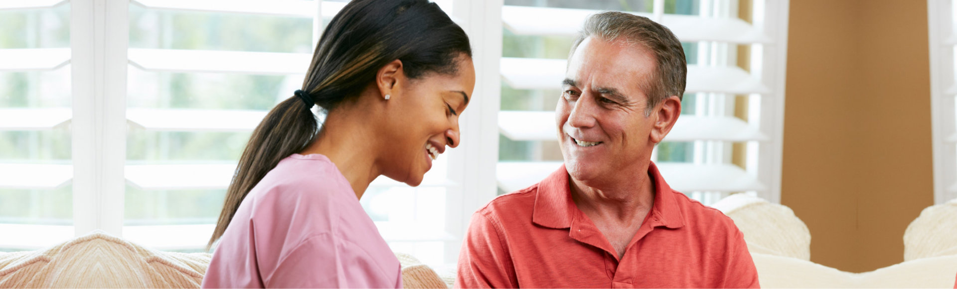 patient looking to his caregiver while smiling
